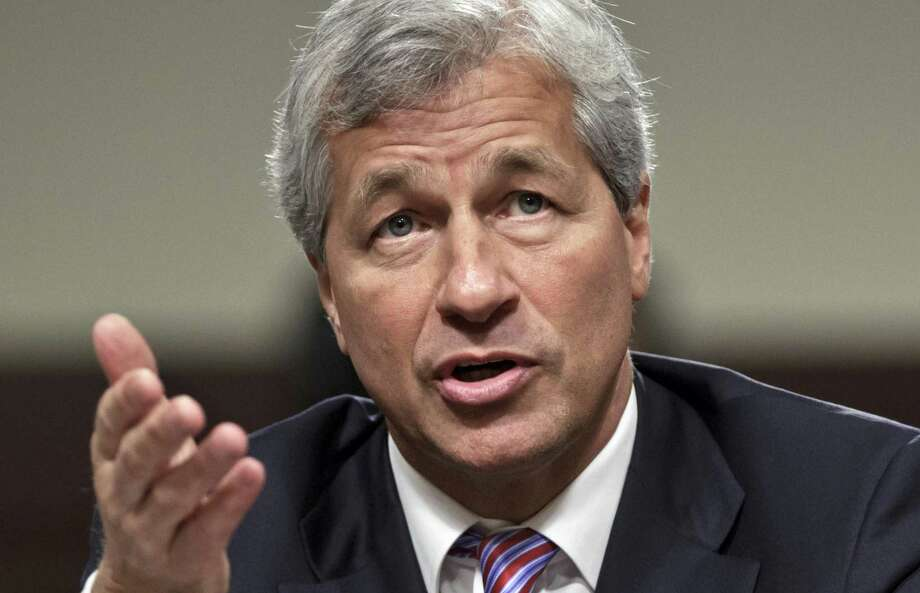 JPMorgan Chase CEO Jamie Dimon testifies before the Senate Banking Committee on Capitol Hill in Washington in 2012. During calls with reporters and Wall Street analysts on Friday, Dimon vented his irritation with politicians and the news media, arguing that the nation is spending too much time bickering instead of solving real issues. Photo: Associated Press File Photo / Copyright 2017 The Associated Press. All rights reserved.