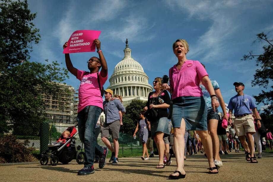 Activists march around the U.S. Capitol to protest the Senate GOP health care bill on June 28. A reader offers his own criticism of the bill. Photo: Drew Angerer / / 2017 Getty Images