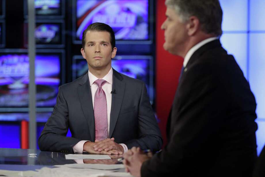 The Trump camp's claim that there was no collussion between Russian and the campaign is now officially dead with Donald Trump Jr.'s release of emails that show precisely that intent. Here Trump Jr., left, is interviewed by host Sean Hannity on his Fox News Channel television program, in New York on Tuesday. Photo: Richard Drew /Associated Press / AP