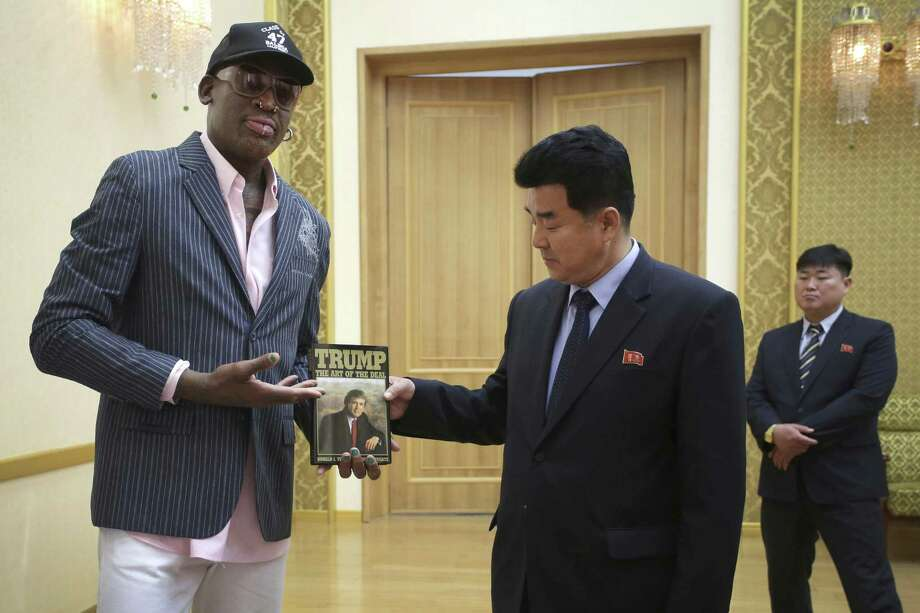 "Former NBA star Dennis Rodman presents ""Trump: The Art of the Deal"" to North Korean Sports Minister Kim Il Guk on June 15. A reader says that any U.S. attempt to engage North Korea in diplomacy would be absurd, especially if Rodman enters the picture. Photo: Kim Kwang Hyon /Associated Press / Copyright 2017 The Associated Press. All rights reserved."