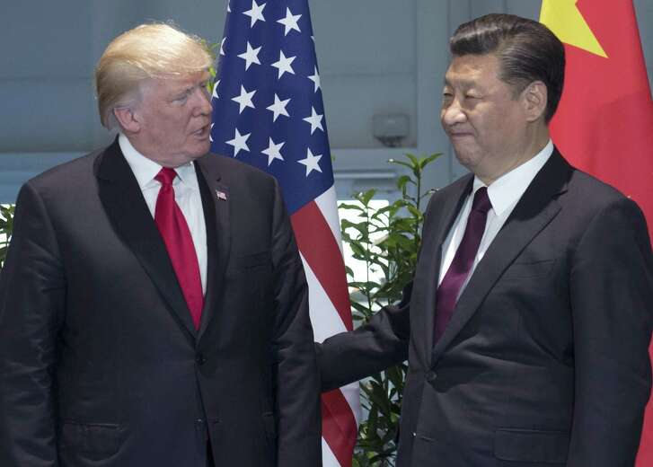 President Donald Trump, left, and Chinese President Xi Jinping arrive for a meeting on the sidelines of the G-20 Summit in Hamburg, Germany last week. Antipathy toward Trump is fueling talk of China assuming the U.S. mantle of global leadership.