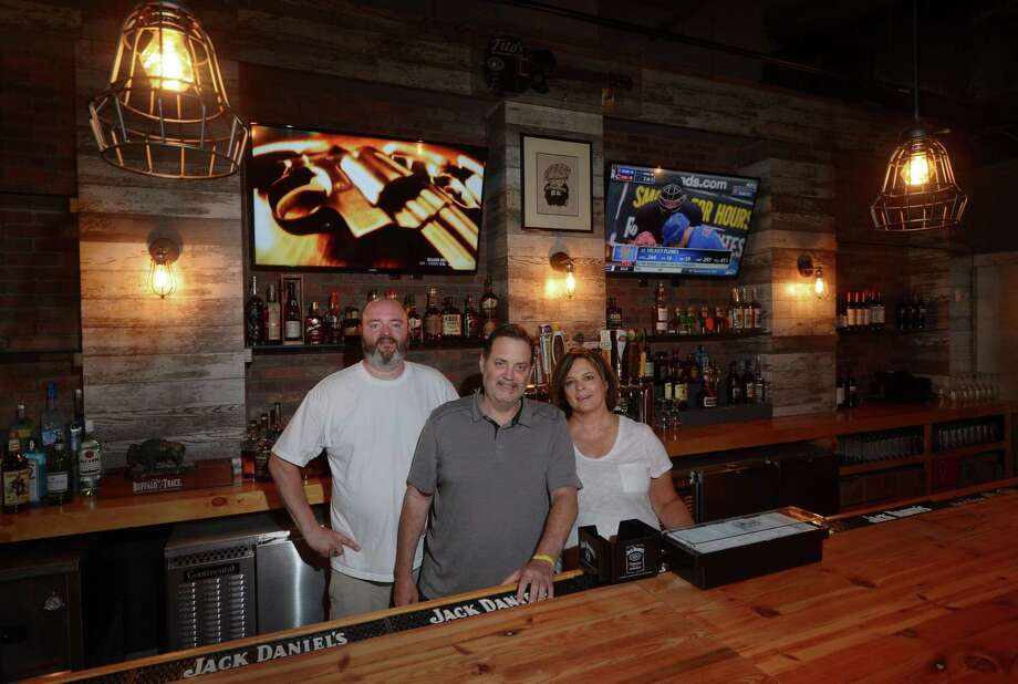 Bobby Q's restaurant chef Ole Knudsen and owners, Robert and Kelly Lerose, at their new location Friday, July 14, 2017, at 11 Merwin St. in Norwalk, Conn. The at BBQ joint which closed in Westport six months ago will be reopening next week in Norwalk. Photo: Erik Trautmann / Hearst Connecticut Media / Norwalk Hour