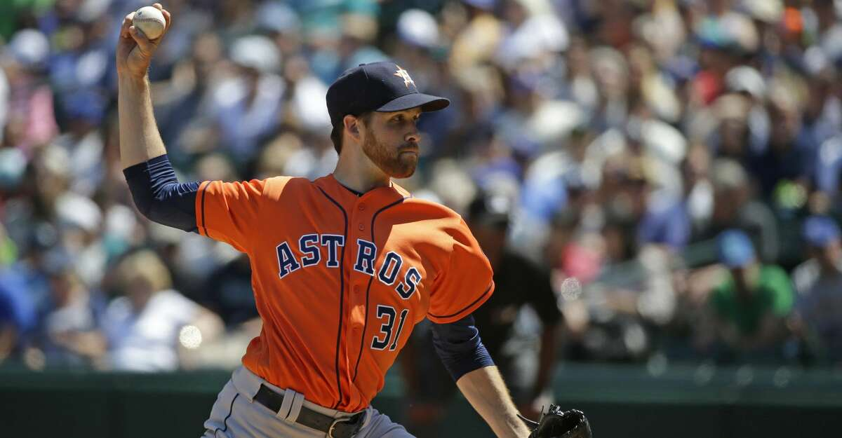 Houston Astros starting pitcher Collin McHugh throws against the Seattle Mariners in the first inning of a baseball game, Sunday, July 17, 2016, in Seattle. (AP Photo/Ted S. Warren)