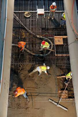 Workers pour concrete to create the Union Square station platform of the Central Subway project, over one hundred feet below the surface in San Francisco, Ca., as seen on Wednesday July 12, 2017.