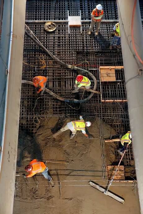 Workers pour concrete to create the Union Square station platform of the Central Subway project, over one hundred feet below the surface in San Francisco, Ca., as seen on Wednesday July 12, 2017. Photo: Michael Macor, The Chronicle