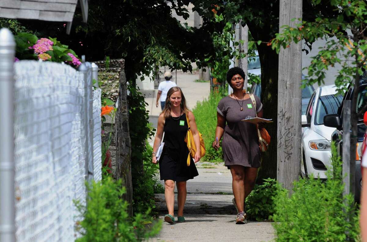 Volunteer canvassers Nicole Cassidy, left, and Jasmine Bramwell of Bridgeport Generation Now go house to house along Pequonnock Street in Bridgeport, Conn., on Saturday July 8, 2017. Bridgeport Generation Now is canvassing with other progressive organizing groups as part of a voter engagement campaign called BPT Votes!