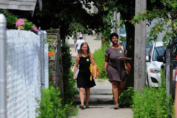 Volunteer canvassers Nicole Cassidy, left, and Jasmine Bramwell of Bridgeport Generation Now go house to house along Pequonnock Street in Bridgeport, Conn., on Saturday July 8, 2017. Bridgeport Generation Now is canvassing with other organizing groups as part of progressive political politicking ahead of the fall municipal election.