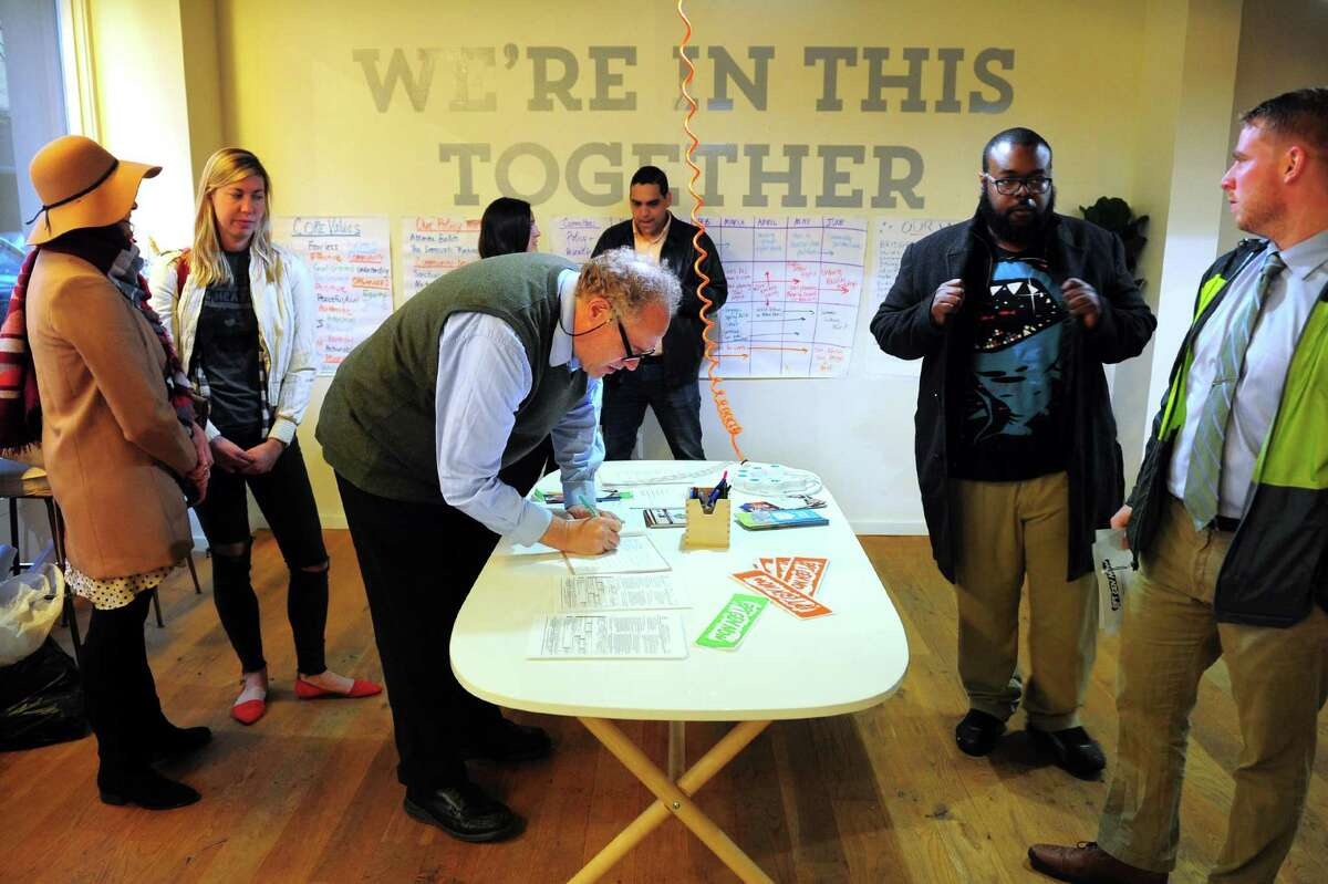 Bridgeport Generation Now member Douglass Davidoff signs in before taking part in the group's monthly meeting at B:Hive on Fairfield Ave in Bridgeport, Conn., on Wednesday Apr. 19, 2017. Generation Now is a grassroots social action network working to bring about more civic engagement. The group meets every third Wednesday of the month at the B:Hive starting at 7 p.m.