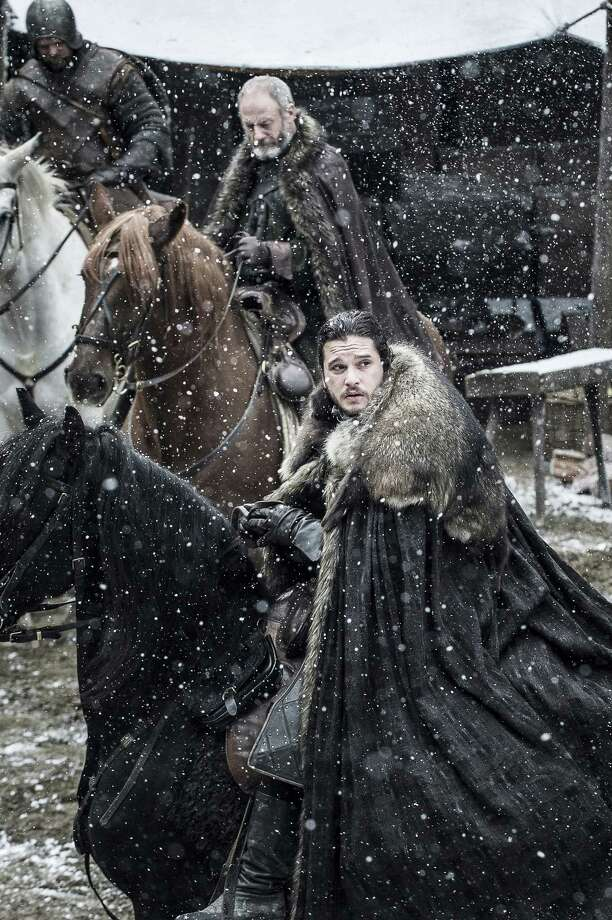 """Davos Seaworth (Liam Cunningham, background) and Jon Snow (Kit Harington) have been kept extremely busy in Season 7 of """"Game of Thrones."""" Photo: Helen Sloan/courtesy Of HBO"""