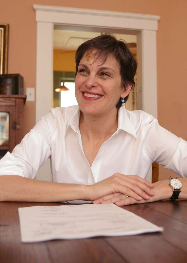 "Texas-based writer Mimi Swartz talks about her new book about Enron called ""Power Failure,"" Thursday, March 13, 2003, in her Houston home. Swartz worked with whistle blower Sherron Watkins on the book.  ""Power Failure,"" to be released Tuesday, March 25, 2003, chronicles the Houston-based company's road to scandal.  (AP Photo/Michael Stravato) Photo: MICHAEL STRAVATO, STR / AP"