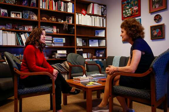 Shira Rutman, left, research coordinator, and Dr. Claire Brindis, right, speak in Brindis' office at UCSF Laurel Heights campus in San Francisco on Friday, June 30, 2017.