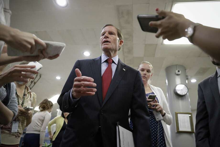 Sen. Richard Blumenthal, D-Conn., speaks to reporters looking for comment on the Senate Republican healthcare bill on his way to a vote on Capitol Hill in Washington, Wednesday, July 12, 2017. Photo: J. Scott Applewhite / Associated Press / Copyright 2017 The Associated Press. All rights reserved.