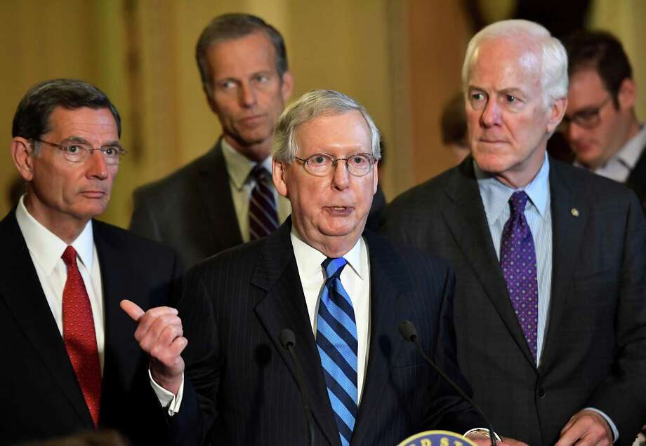"FILE – Senate Majority Leader Mitch McConnell (R-Ky.) at the Capitol in this file photo from Thursday, July 13. McConnell said the Senate will ""defer consideration"" of the healthcare bill, scheduled for this week, because Sen. John McCain, R-Ariz., would be absent, recovering from surgery he had Friday. Photo: Katherine Frey / The Washington Post / The Washington Post"