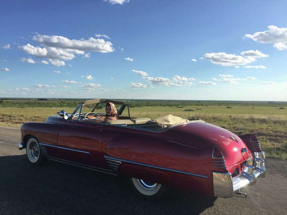 """A classic cherry-red Cadillac in """"The Iron Orchard"""" belongs to David Arrington of Midland. / Houston Chronicle"""