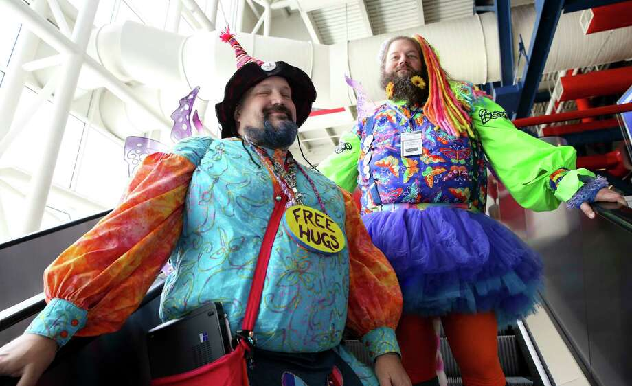 Dim n Wit, the Fairy Brothers riding the escalator back to the Comicpalooza after their panel discussion Sunday, May 14, 2017, in Houston. Dave Bang, right, is Wit and Dave Cline is Dim. ( Yi-Chin Lee / Houston Chronicle ) Photo: Yi-Chin Lee, Staff / © 2017  Houston Chronicle