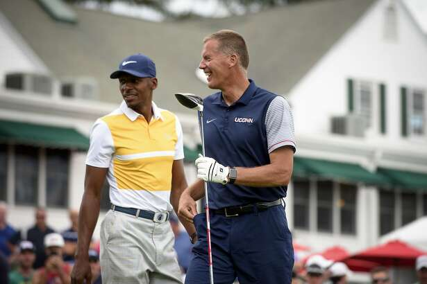 Former Connecticut basketball player Ray Allen and Connecticut football coach Randy Edsall react after hitting on the first hole at the Travelers Championship at TPC River Highlands, Wednesday, June 21, 2017 in Cromwell, Conn. (Mark Mirko/Hartford Courant via AP)