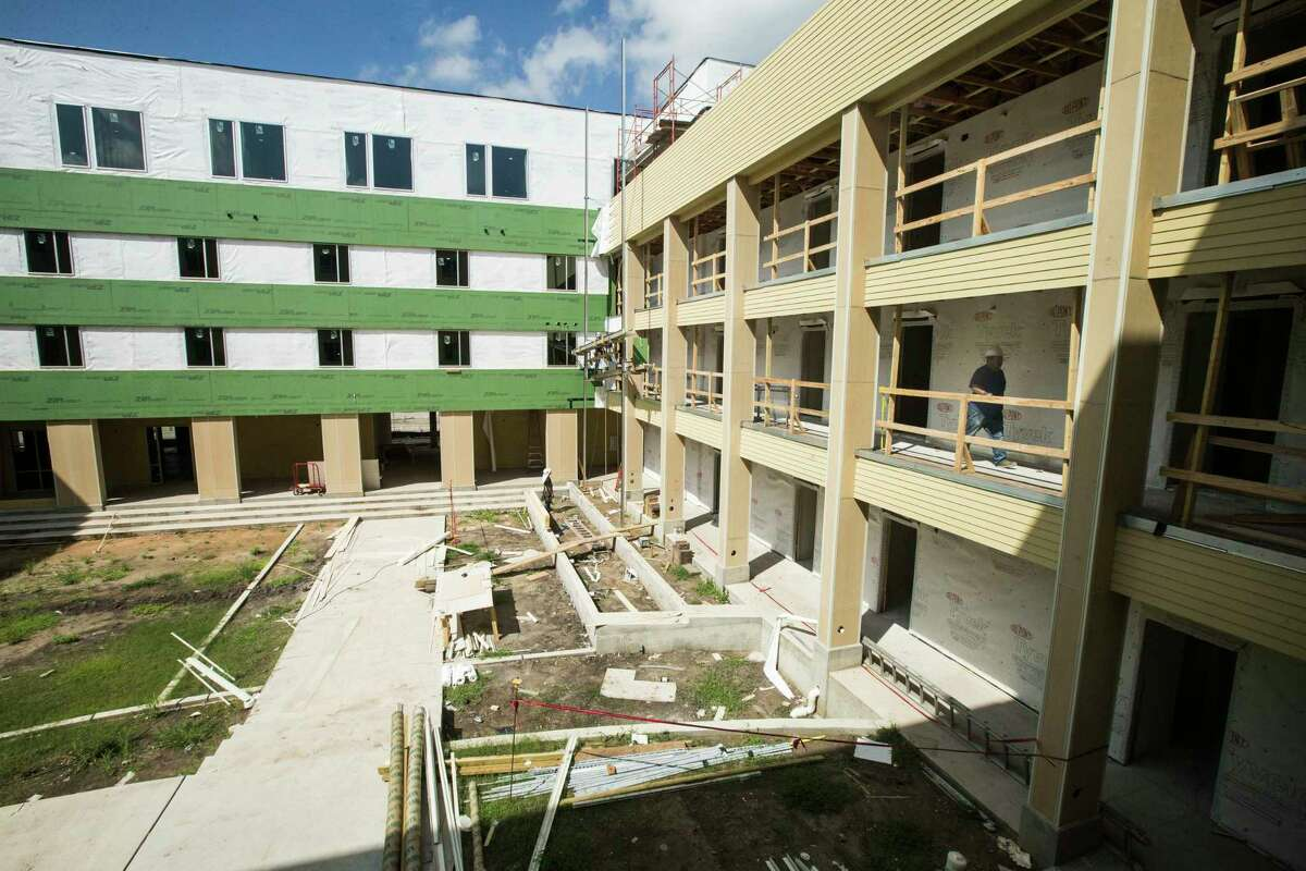 Construction workers build at New Hope Housing on Harrisburg on Friday, July 14, 2017, in Houston. The complex is being built through bond money slated for housing.