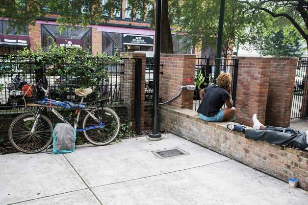 Clients at The Beacon homeless services center use the improved courtyard area on Friday, July 14, 2017, in Houston. Improvements were made through bond money slated for housing. Photo: Brett Coomer, Houston Chronicle / © 2017 Houston Chronicle