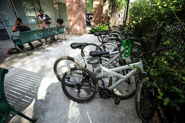 Clients at The Beacon homeless services center use the improved courtyard area and bicycle racks on Friday, July 14, 2017, in Houston. Improvements were made through bond money slated for housing. Photo: Brett Coomer, Houston Chronicle / © 2017 Houston Chronicle