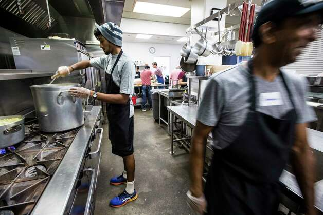 Volunteer Steva Wijayasinha cooks in the newly-expanded kitchen at The Beacon homeless services center on Friday, July 14, 2017, in Houston. Improvements were made through bond money slated for housing. Photo: Brett Coomer, Houston Chronicle / © 2017 Houston Chronicle