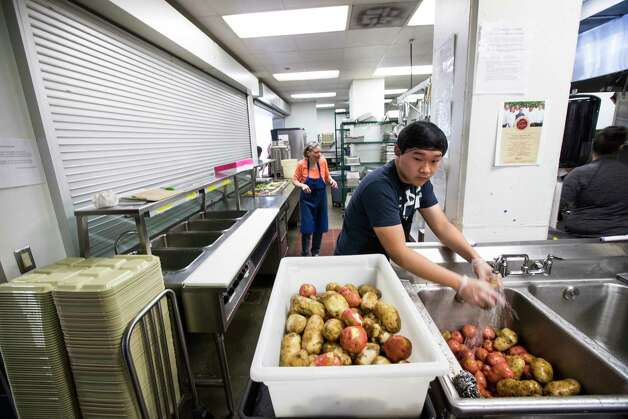 Volunteer Daniel Lee washes potatoes in the expanded kitchen at The Beacon homeless services center on Friday, July 14, 2017, in Houston. Improvements were made through bond money slated for housing. Photo: Brett Coomer, Houston Chronicle / © 2017 Houston Chronicle