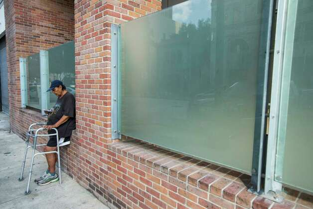 Betty Louise Thornton sits net to a new privacy wall installed at The Beacon homeless services center on Friday, July 14, 2017, in Houston. Improvements were made through bond money slated for housing. Photo: Brett Coomer, Houston Chronicle / © 2017 Houston Chronicle