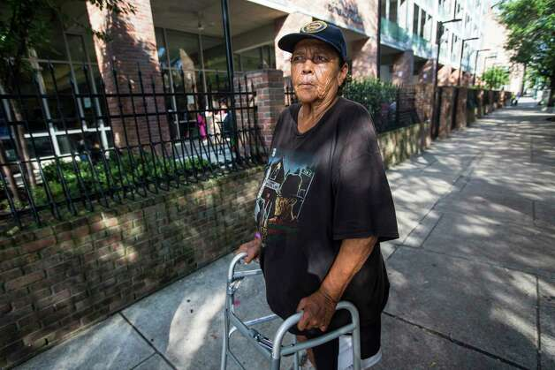 Betty Louise Thornton stands outside an improved fence at The Beacon homeless services center on Friday, July 14, 2017, in Houston. Improvements were made through bond money slated for housing. Photo: Brett Coomer, Houston Chronicle / © 2017 Houston Chronicle