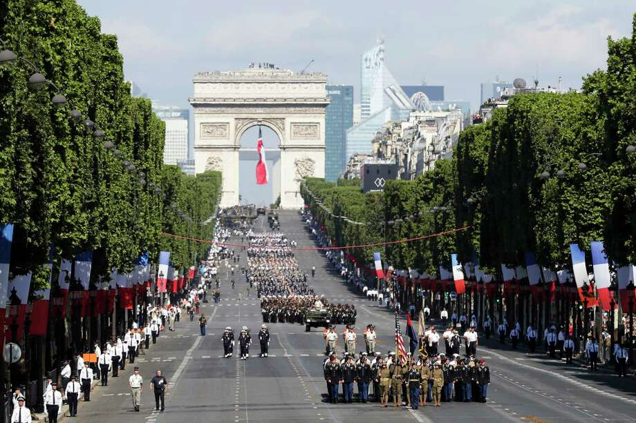 U.S troops march down the Champs Elysees avenue, with the Arc de Triomphe in background, during the Bastille Day parade in Paris, Friday, July 14, 2017. Paris has tightened security before its annual Bastille Day parade, which this year is being opened by American troops with President Donald Trump as the guest of honor to commemorate the 100th anniversary of the United States' entry into World War I. (AP/Photo/Markus Schreiber) Photo: Markus Schreiber, STF / Copyright 2017 The Associated Press. All rights reserved.