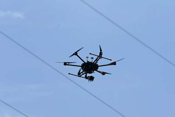 New Braunfels Utilities demonstrates how is using a drone to inspect about five miles elevated electrical lines rather than the traditional method of visual inspection by an employee in a bucket. The drone flown by Survey and Mapping LLC of Austin will film and conduct thermal imaging of the power lines under the $35,000 trial contract.     on Friday, July 13, 2017
