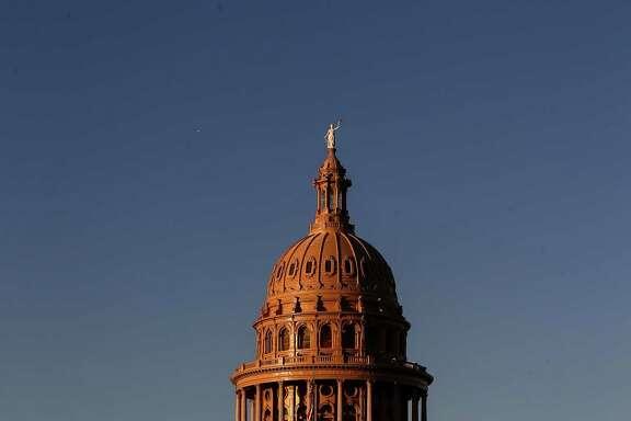 The sun sets over the Texas Capitol in Austin. ( Jon Shapley / Houston Chronicle)
