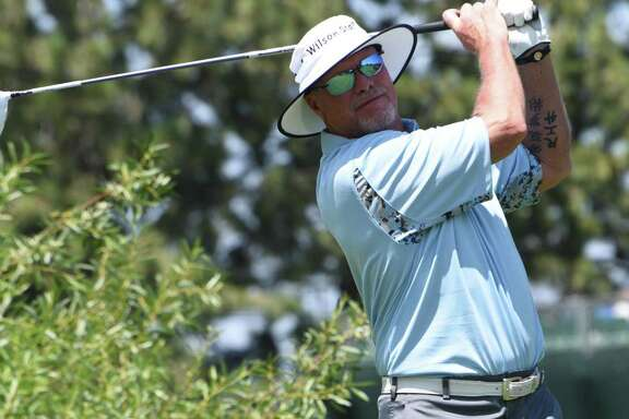 Jim McMahon tees off during the opening round of the American Century Championship.