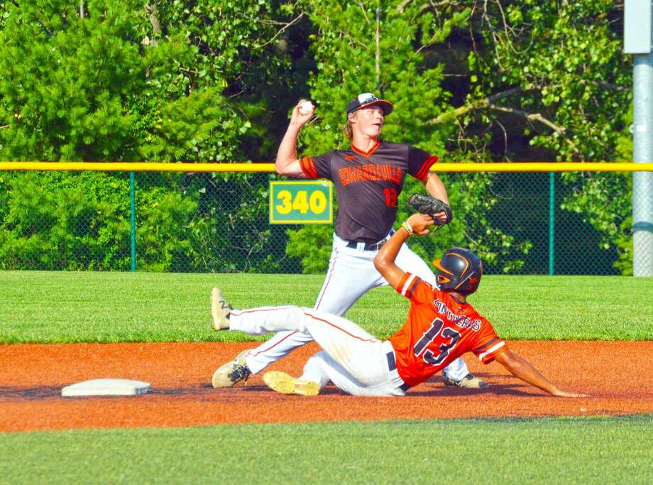 Edwardsville shortstop Jonathon Yancik fires a throw to first to try and complete a double play during Friday's game against the BTL Hornets on the junior varsity field.
