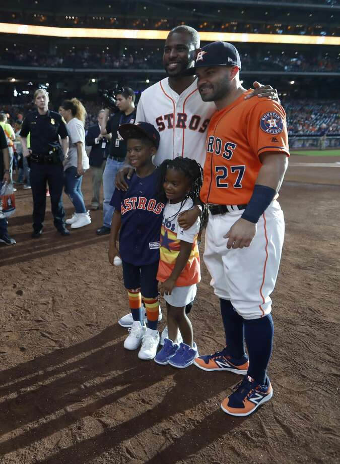 Houston Rockets Chris Paul speaks to Jose Altuve with his daughter Camryn and son Christopher Paul II, as he prepared to throw out the first pitch before the start of an MLB baseball game at Minute Maid Park, Friday, July, 14, 2017. ( Karen Warren / Houston Chronicle ) Photo: Karen Warren/Houston Chronicle