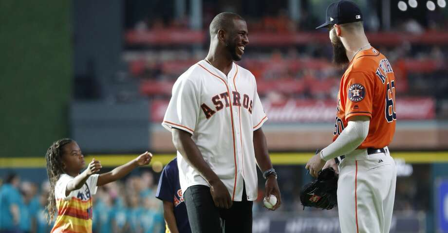 Houston Rockets Chris Paul greets Houston Astros Dallas Keuchel after throwing out the first pitch before the start of an MLB baseball game at Minute Maid Park, Friday, July, 14, 2017. ( Karen Warren / Houston Chronicle ) Photo: Karen Warren/Houston Chronicle