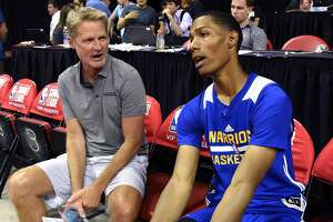 LAS VEGAS, NV - JULY 12:  Head coach Steve Kerr (L) of the Golden State Warriors talks with Patrick McCaw #0 of the Warriors after the team defeated the Minnesota Timberwolves 77-69 during the 2017 Summer League at the Thomas & Mack Center on July 12, 2017 in Las Vegas, Nevada. NOTE TO USER: User expressly acknowledges and agrees that, by downloading and or using this photograph, User is consenting to the terms and conditions of the Getty Images License Agreement.  (Photo by Ethan Miller/Getty Images)