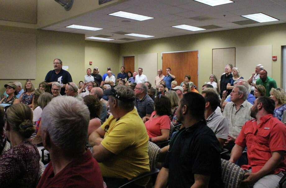 About 100 residents of Copper Ridge, a subdivision in Comal County that ran out of water on July 7, 2017, gathered at New Braunfels Utilities offices on July 13, 2017, to question the utility about what caused the problem. Photo: Brendan Gibbons /San Antonio Express-News