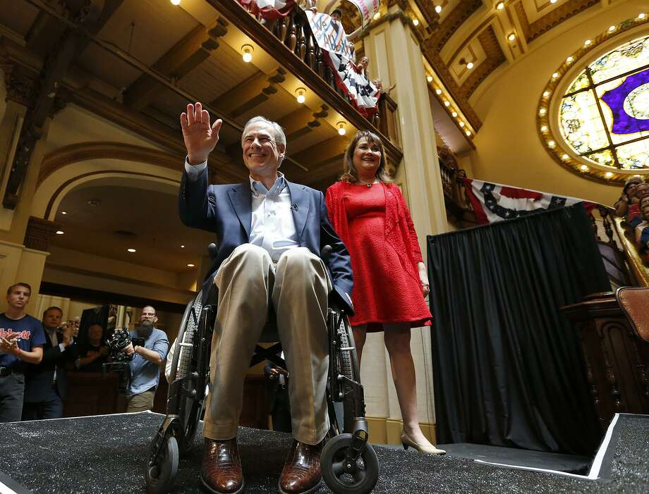 Texas Gov. Greg Abbott and his wife Cecilia Abbott arrive for an event to announce his bid for re-election July 14 at Sunset Station. He's running to thwart liberals. Photo: Edward A. Ornelas /San Antonio Express-News / © 2017 San Antonio Express-News
