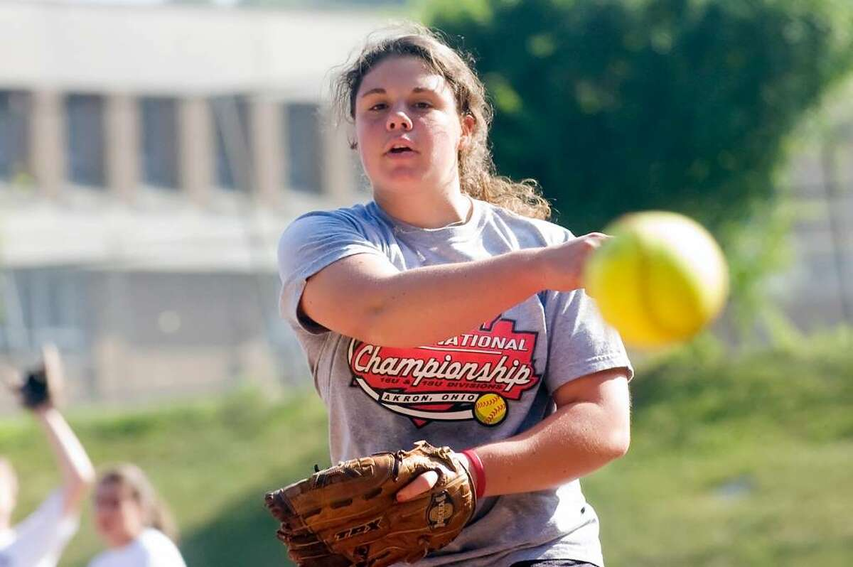 Pitcher Jen Joseph perfects her throw as Westhill High School softball team practices for Saturday's state final.June 10, 2010.