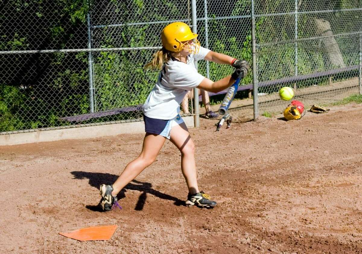 Allie Macari hits as Westhill High School softball team practices for Saturday's state final.June 10, 2010.