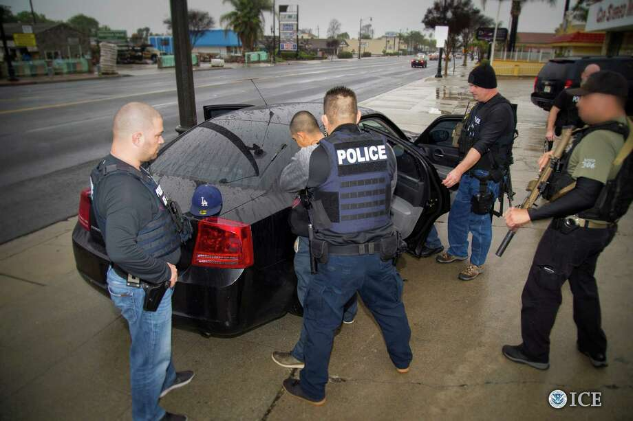 Immigration and Customs Enforcement officers detain a suspect in Los Angeles earlier this year. The Trump administration is trying to harden policies regarding illegal immigration.  Photo: U.S. IMMIGRATION AND CUSTOMS ENFORCEMENT, HO / U.S. IMMIGRATION AND CUSTOMS ENFORCEMENT