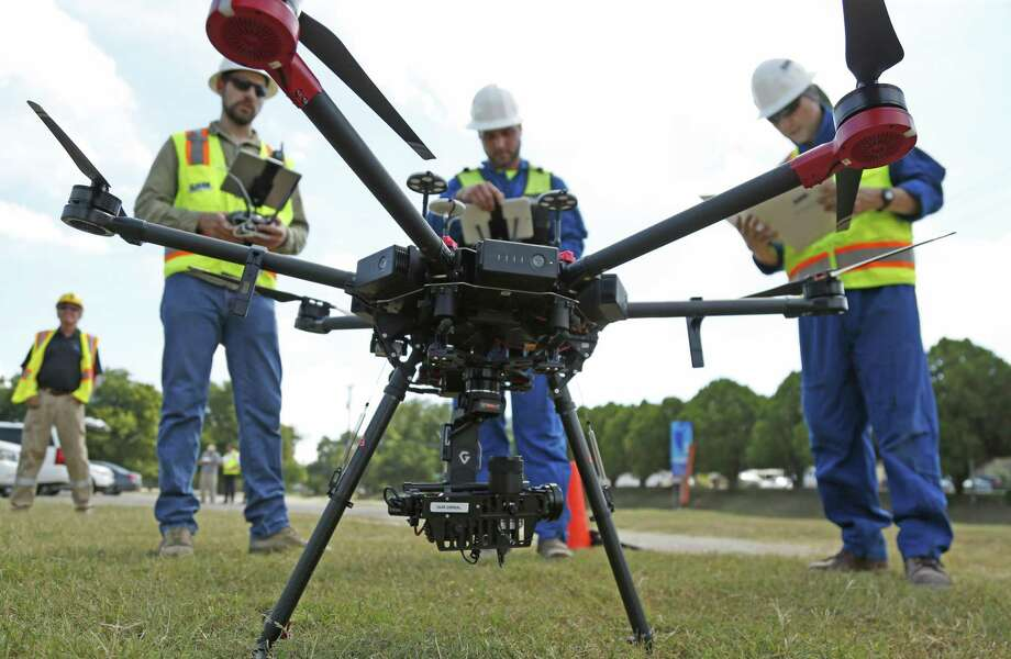 New Braunfels Utilities demonstrates Friday how it will use a drone to inspect about 5 miles elevated electrical lines rather than the traditional method of visual inspection by an employee in a bucket. Photo: Ron Cortes /For The San Antonio Express-News / Freelance