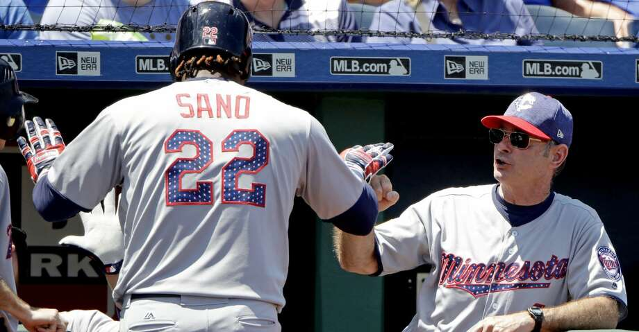 Minnesota Twins' Miguel Sano (22) celebrates with manager Paul Molitor after hitting a solo home run during the third inning of the first baseball game of a doubleheader against the Kansas City Royals Saturday, July 1, 2017, in Kansas City, Mo. (AP Photo/Charlie Riedel) Photo: Charlie Riedel/Associated Press