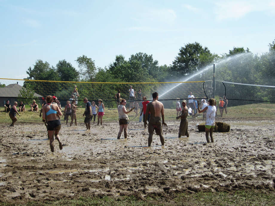 The mud volleyball courts get an extra soaking during a previous tournament at the Moose Lodge. Photo: Parks And Recreation