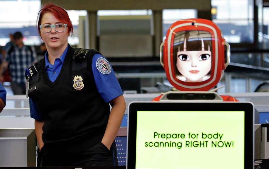 A robot provides suggestions to speed the trip through security at Seattle-Tacoma International Airport. Photo: Elaine Thompson, STF / Copyright 2017 The Associated Press. All rights reserved.