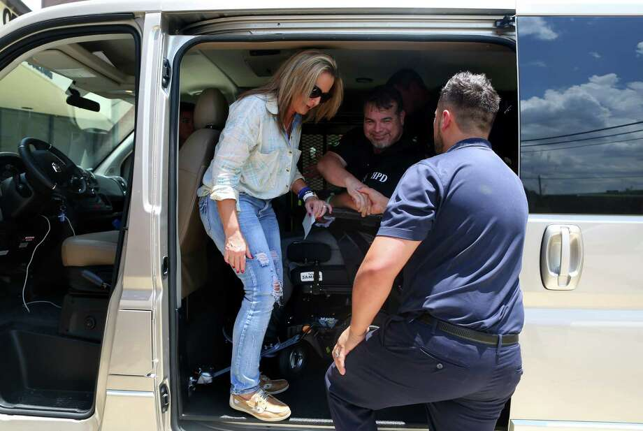 """Officer Ronny Cortez is all smiles after being loaded into his new van provided by the 100 Club after its presentation on Friday at the Houston Police Officers Union building. """"This guy … and his family, they're our heroes,"""" said Police Chief Art Acevedo. Photo: Annie Mulligan, Freelance / @ 2017 Annie Mulligan Houston Chronicle"""