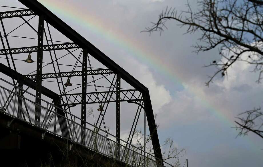A rainbow is pictured behind the Hays Street Bridge as storms move through the area on Jan. 15. Photo: Edward A. Ornelas /San Antonio Express-News / © 2017 San Antonio Express-News