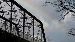 A rainbow is pictured behind the Hays Street Bridge as storms move through the area on Jan. 15.