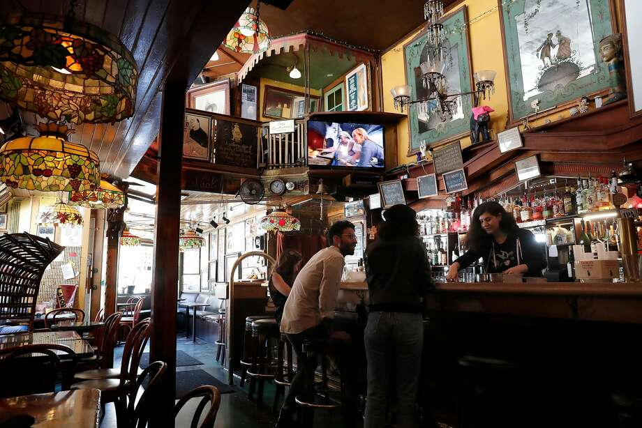 VesuvioSpend enough time observing people in this North Beach bar on the other side of City Lights bookstore on Jack Kerouac Alley, and you might come up with enough material for your own novel. Vesuvio was a prime hangout for Beat Generation writers such as Kerouac, Neal Cassady, and Allen Ginsberg in the 1950s and 60s, and it's aged beautifully since. When you walk up and down Vesuvio's two stories and admire its murals, stained glass lamps, historic photos, and regulars from all walks of life, you're walking through a museum.What makes Vesuvio special: Drinking from a booth or table on the balcony and looking down on the buzz of the bar offers a sublime perspective. And while North Beach nightlife may be attract a large bridge-and-tunnel crowd, Vesuvio will always be a locals' bar. Here you'll find bartenders, strippers on break, politicians, everyday residents, and everyone else who makes the neighborhood what it is.What to drink at Vesuvio: Either the Jack Kerouac cocktail with rum, tequila and orange and cranberry juice, or the Bohemian Coffee with coffee, brandy, amaretto, and a twist of lemon. Photo: Michael Macor, The Chronicle