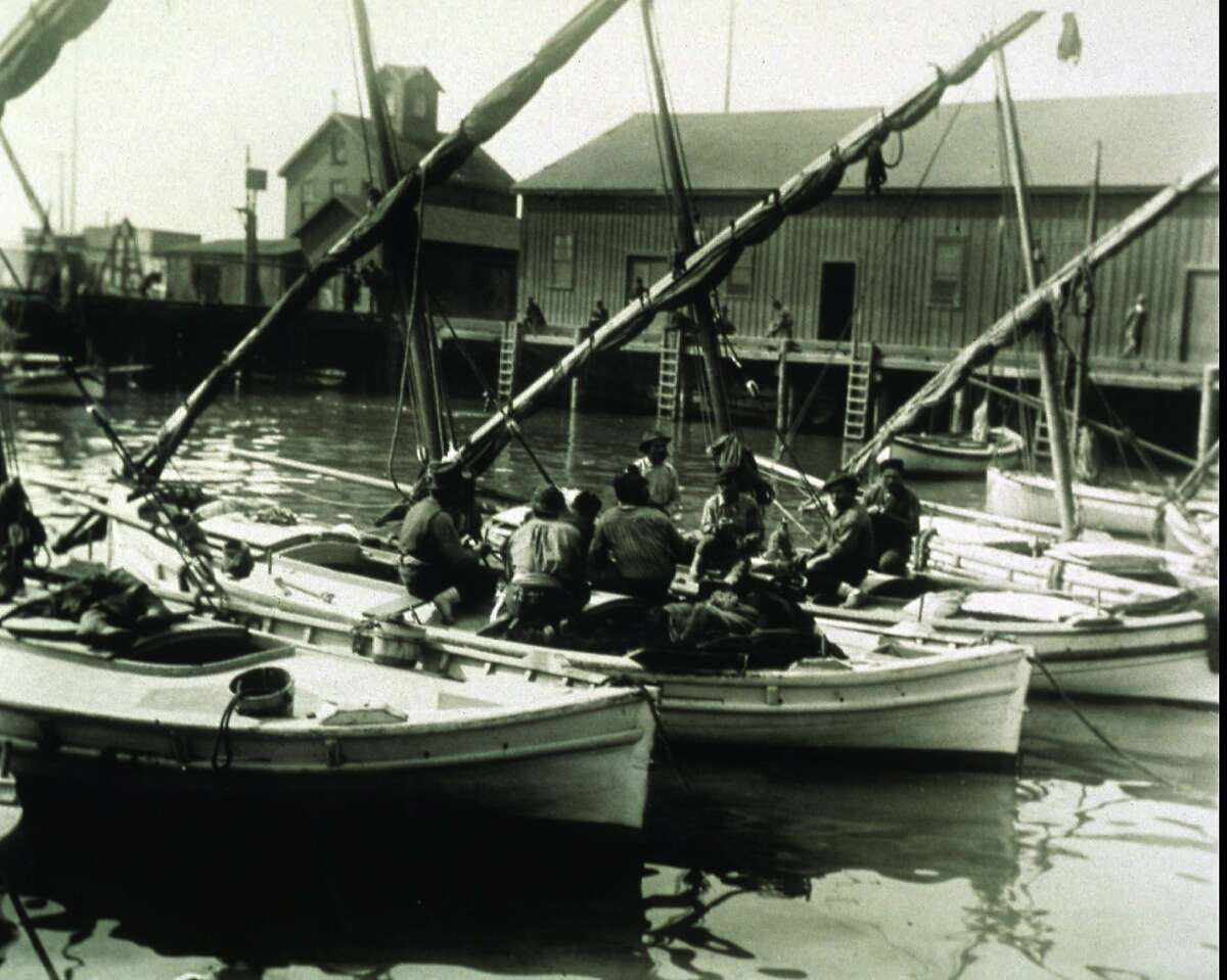 Circa 1900: Italian fishermen relax and discuss the catch of the day in their felucca sailing boats at San Francisco's famed Fisherman's Wharf. (AP Photo/San Francisco Historical Society)