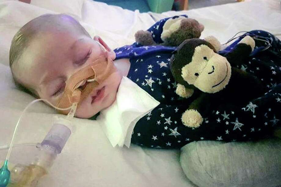 This is an undated photo of sick baby Charlie Gard provided by his family, taken at Great Ormond Street Hospital in London. A British court will assess new evidence Monday July 10, 2017, in the case of 11-month-old Charlie Gard as his mother pleaded with judges to allow the terminally ill infant to receive experimental treatment for his rare genetic disease, mitochondrial depletion syndrome. (Family of Charlie Gard via AP) ORG XMIT: LON801 / Family of Charlie Gard